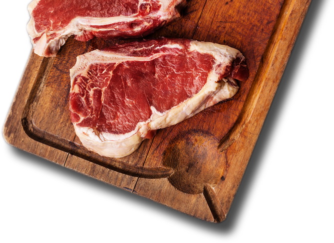 Wood cutting board featuring two fresh cuts of T-Bone Steak